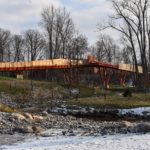 Side view of Orange Bridge at Whiting Forest over Snake Creek in winter